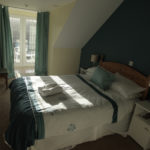 A bright, nicely decorated bedroom with a double bed